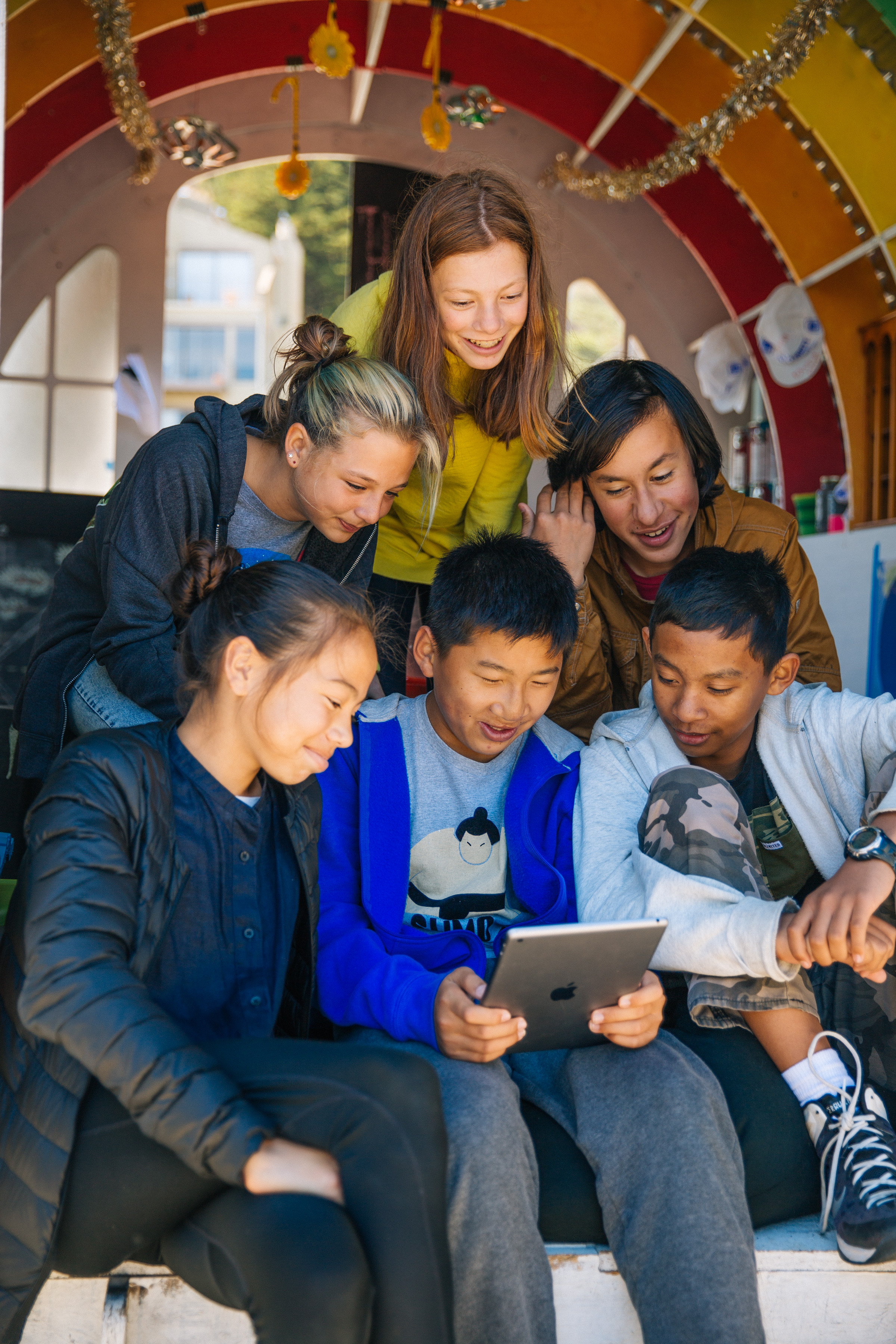 group of children reading from a tablet
